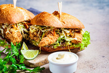 Crispy Fried Chicken Sandwiches With Coleslaw Salad On The Board.