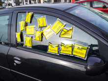 A Car Has Parking Charge Notice Tickets On The Side Window More Commonly Known As A Parking Ticket. It Is Parked In A Restricted Zone With Residential Parking Only.