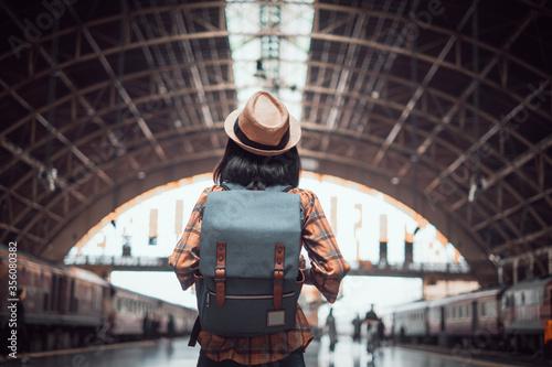 Valokuvatapetti asian woman tourist traveller backpack to train station