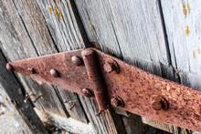 Rusty Hinge On Wooden Door