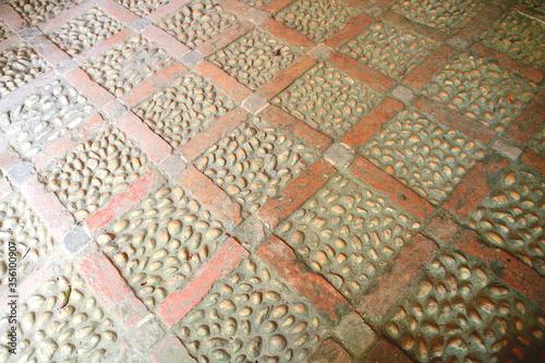 A brick laid floor in a diamond pattern inlaid with beach pebbles to create this Victorian floor of diamonds with quartz cobbles Tapéta, Fotótapéta