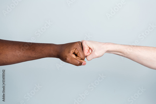 Foto Closeup photo of two arms different race skin colors multinational friends antir