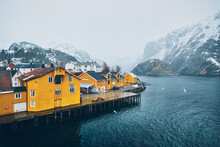 Panorama Of Nusfjord Authentic Fishing Village With Yellow Rorbu Houses In Norwegian Fjord In Winter. Lofoten Islands, Norway
