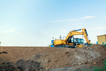 Excavator On The Construction Of A Road Embankment