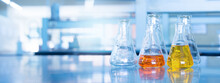 Orange Yellow Solution In Science Glass Flask Win Blue Chemistry Laboratory Banner Background