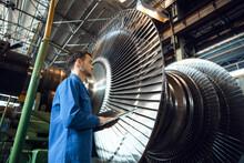 Engineer Checks Turbine Impeller Vanes, Factory