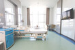 Recovery Room with beds and comfortable medical. Interior of an empty hospital room. Clean and empty room with a bed in the new medical center