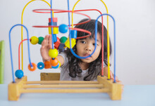 Autistic Girl Concentrating Pl...