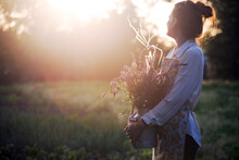 Girl In The Village Works In The Garden