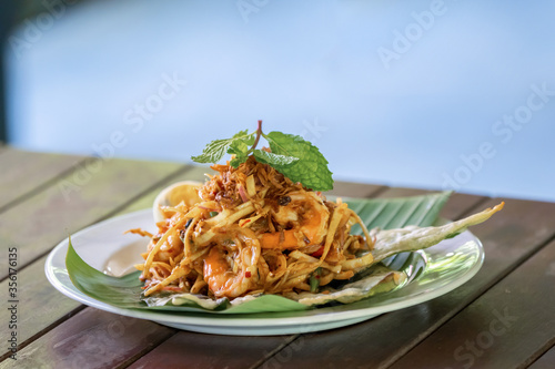 """""""Yum Hua Plee"""" is the  spicy banana blossom salad from Thailand local traditional North area is shot on the wood table Wallpaper Mural"""