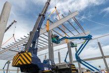Construction Worker Working At Boom Lift Installation Steel Roof Beam