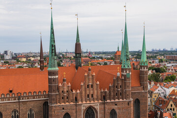 Gdansk, Poland - Juny, 2019: Red roofs, old buildings and colorful houses in Old Town Stare Miasto in Gdansk, aerial view from cathedral St. Mary's Church tower, Poland