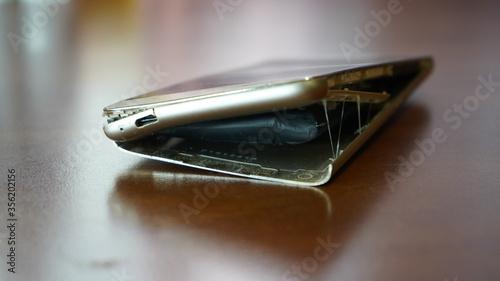 Photo Swollen smartphone battery