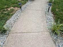 Grey Cement Path With Solar Li...