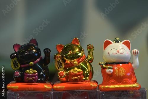 Vászonkép Welcoming cat oriental souvenir on sale in oriental fair Turin Italy March 25 20