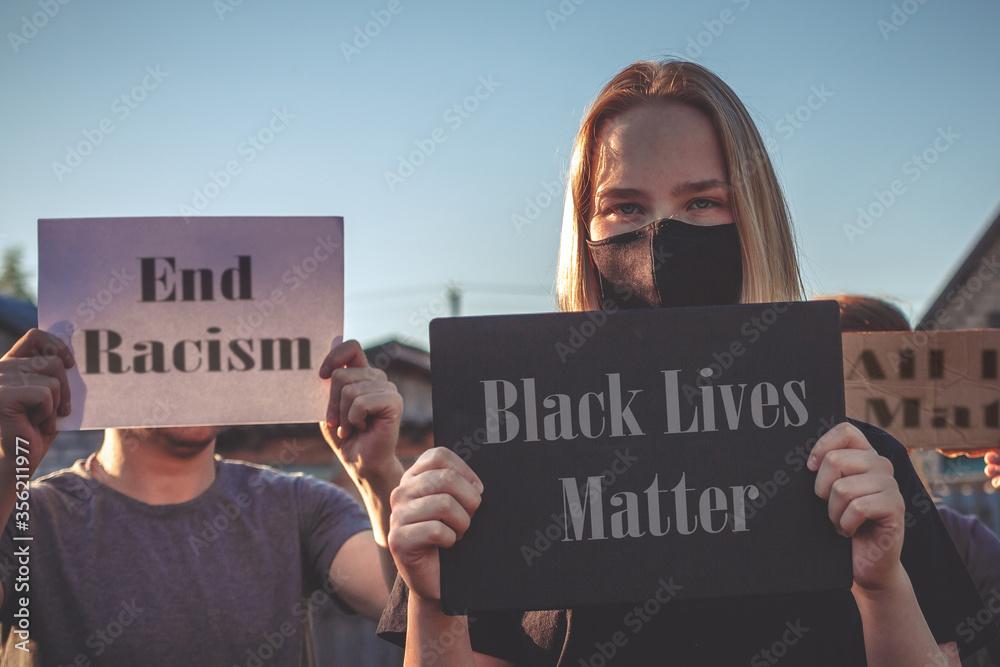 Fototapeta Black Lives Matter Protest Against Ending Racism Poster Over Human Rights Violation. The big hand is a symbol of anti-racism, equality. Phrase message Black Lives Matter