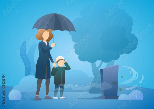 Sad woman with son grieving in a cemetery Canvas Print