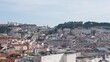 Lisbon city panoramic view pan shot of Alfama quarter colorful buildings on a sunny day