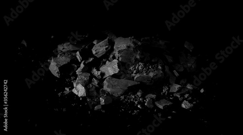 Cuadros en Lienzo Pile black coal isolated on black background, clipping path