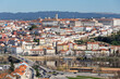 historic Coimbra cityscape with university at top of the hill in the evening, Portugal
