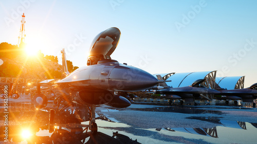 Photo f 16 military fighter jet. military base. sunset. 3d rendering.