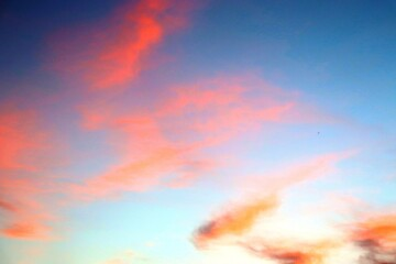 Sunset in watercolor colors, reds, blues and yellows, sunbeams at dawn