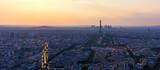 Fototapeta Paryż - Panoramic aerial view of Paris, Eiffel Tower and La Defense business district. Aerial view of Paris at sunset. Panoramic view of Paris skyline with Eiffel Tower and La Defense. Paris, France.