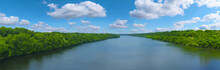 The Big Mississippi River Panorama With Blue Sky And White Clouds