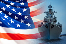 The Concept Is The Us Navy. Front View Of The Battleship Against The American Flag. American Fleet. Weapons Of The American Army. Participation Of Military Vessels In Conflicts At Sea.