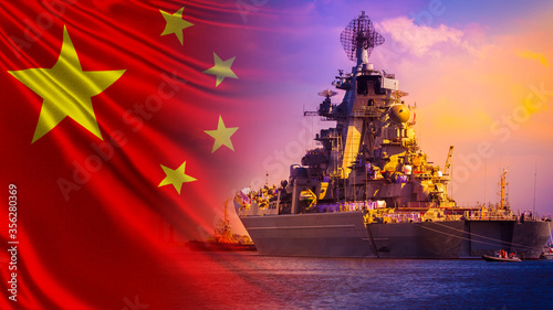 Photo A warship with lined up sailors on Board against the background of the flag of China