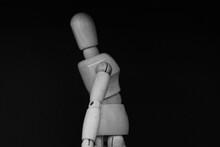 Wooden Mannequin Standing On B...