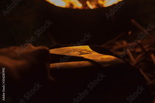 Closeup shot of an ax on the pile of firewood Canvas Print