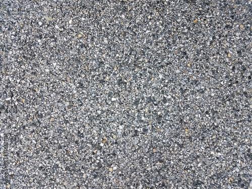 Fotografija black, white, and grey stones or rocks on asphalt