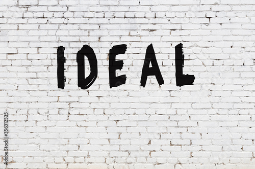 Photo Word ideal painted on white brick wall