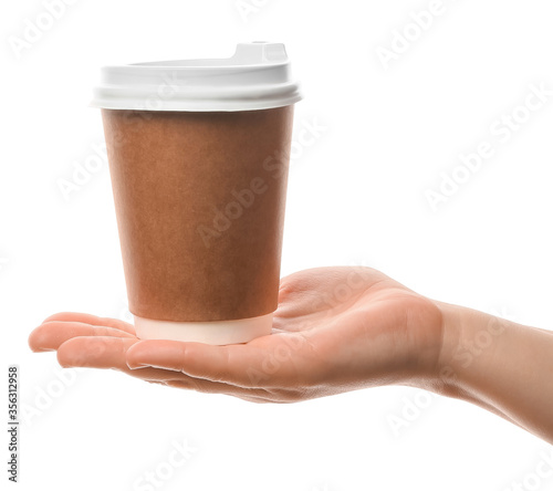 Fototapeta Female hand with cup of coffee on white background obraz