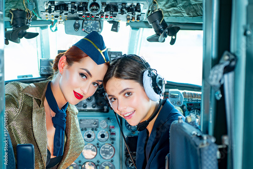 Two women Pilots Sitting in Cabin of Modern Aircraft Tapéta, Fotótapéta