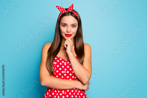 Fototapeta Close-up portrait of nice-looking attractive lovely winsome creative content smart clever straight-haired girl thinking touching chin isolated over bright vivid shine vibrant blue color background obraz