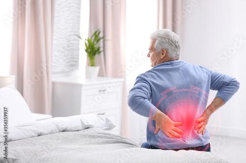 Fotografía Senior man suffering from back pain after sleeping on uncomfortable mattress at