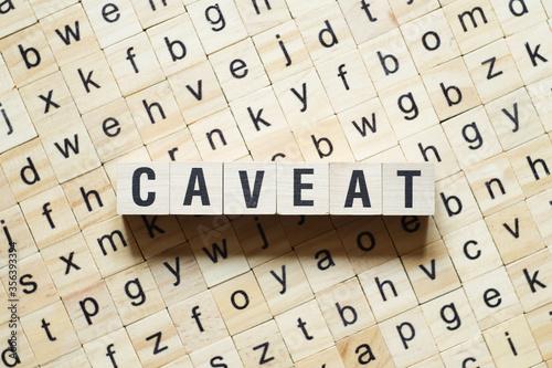 Caveat word concept on cubes Canvas Print