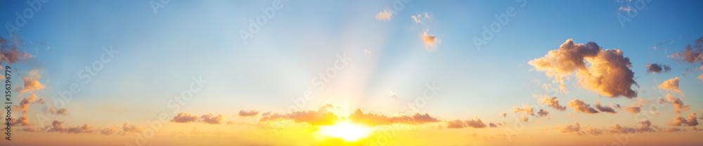 Fototapeta Sunset sky clouds background. Beautiful landscape with clouds and orange sun on sky