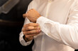 Man. People, business,fashion and clothing concept - close up of man dressing up and adjusting white shirt with cufflinks