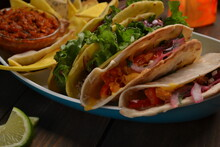 Mexican Tacos With Chicken, Beef, Paprika, Lettuce, Tomatoes And Nachos, Lime Juice, Tequila.