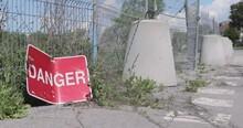 Broken Danger Sign On The Side...