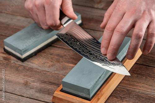 Tela Man sharpens a Gyuto knife using a whetstone