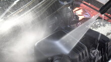 Washes Away Dirt From A Car En...