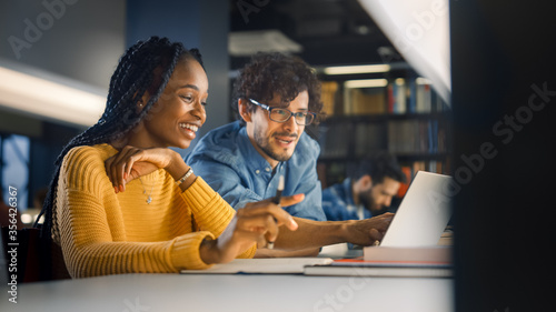 University Library: Gifted Black Girl uses Laptop, Smart Classmate Explains and Helps Her with Class Assignment Canvas Print