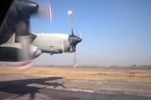 The Propellers On A C-130 Hercules Cargo Aircraft During Take-off From A Runway
