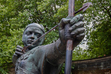 Detail Of The Statue Of Robin Hood Standing Near Nottingham Castle In Nottingham, England.