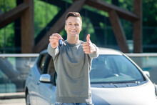 Satisfied Young Man With Key Showing Everything Is Ok