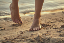 Female Feet Barefoot On A Sand...